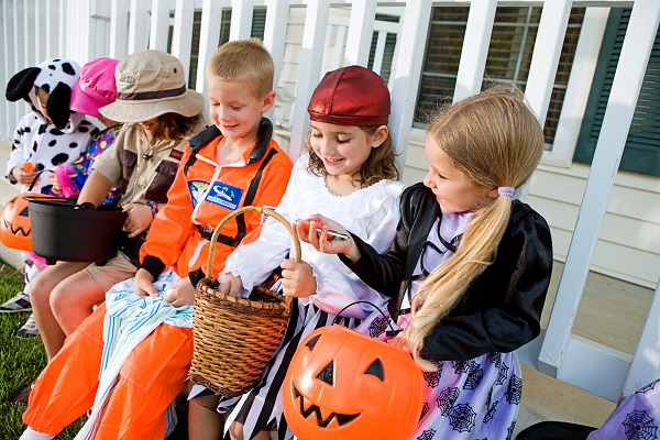 children-counting-halloween-candy